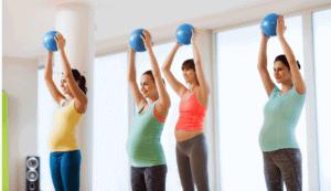 female yoga class with yoga balls